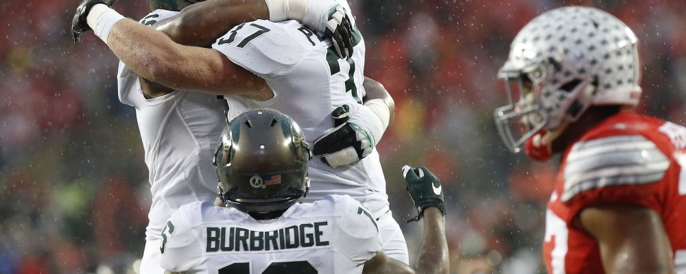 Nov 21, 2015; Columbus, OH, USA; Michigan State Spartans fullback Trevon Pendleton (37) celebrates with Spartans quarterback Damion Terry (6) after scoring a touchdown against the Ohio State Buckeyes in the second quarter at Ohio Stadium. Mandatory Credit: Geoff Burke-USA TODAY Sports ORG XMIT: USATSI-227454 ORIG FILE ID:  20151121_jel_sb4_418.jpg